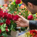 Man buying roses