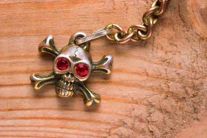 Skull and cross bone trinket on a chain